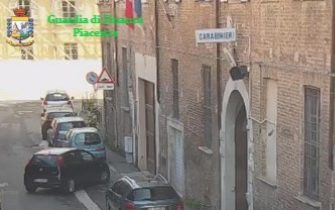 The frame shows a moment of the operation about Carabinieri arrested, barracks impounded at Piacenza, Italy, 22 July 2020. At least six Carabinieri were arrested Wednesday and a barracks belonging to the paramilitary police impounded in the northern city of Piacenza. Some of the Carabinieri were detained in prison and some were placed under house arrest. They have been charged with drug pushing, extortion and torture, among other offences, sources said. ANSA/PRESS OFFICE/GUARDIA DI FINANZA