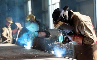 This photo taken on May 3, 2018 shows a worker cutting steel at a factory in Huaibei in China's eastern Anhui province. - China's surplus with the United States widened in April, underlining an imbalance between the economic titans as they struggle to reach an agreement on averting a potentially damaging trade war. (Photo by - / AFP) / China OUT        (Photo credit should read -/AFP via Getty Images)