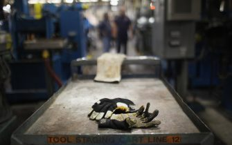 READING, PA - OCTOBER 19:  Work gloves are viewed on the factory floor at Quadrant, a high end plastic processor on October 19, 2011 in Reading, Pennsylvania. Quadrant, a 70 year old company, employs more than 2000 people in 20 countries and is one of the few remaining manufacturers in the area to still provide stable jobs in an uncertain economy. Reading, a city that once boasted numerous industries and the nation's largest railroad company, has recently been named America's poorest city with residents over 65,000. According to new census data, 41.3 percent of people live below the poverty line in Reading. Reading has about 90,000 residents, many of whom are recent Hispanic arrivals who have moved from larger eastern cities over the past decade. While a manufacturing base offering well paying jobs still exists in Reading, many companies like Hershey, Stanley Tool and Dana Systems have either moved elsewhere in the United States or to Mexico in search of cheaper labor. The number of people living in poverty in America, 46.2 million, is now at its highest level for the 52 years the Census Bureau has been keeping records.  (Photo by Spencer Platt/Getty Images)