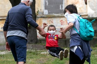 ROME, ITALY - MAY 12: The nephew of the photographer wears a face mask while playing along with his grandparents on May 12, 2020 in Rome, Italy. Italy was the first country to impose a nationwide lockdown to stem the transmission of the Coronavirus (Covid-19). (Photo by Elisabetta A. Villa/Getty Images)