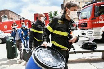 TURIN, ITALY - MAY 15: Firefighters from the NBC sector who specialize in risk intervention carry equipment to the Piedmont Region building in Piazza Castello on May 15, 2020 in Turin, Italy. Emergency services invetigated a suspicious package delivered to the Piedmont Region building in Piazza Castle. Italy was the first country to impose a nationwide lockdown to stem the transmission of the Coronavirus (Covid-19), and its restaurants, theaters and many other businesses remain closed. (Photo by Stefano Guidi/Getty Images)