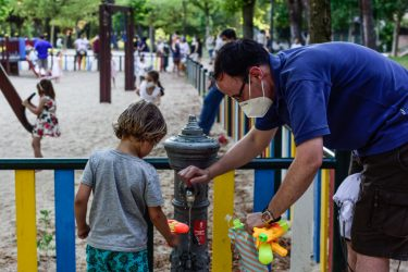 MADRID, SPAIN - JUNE 23: A man fills a toy water gun for a kid in a children's park on June 23, 2020 in Madrid, Spain. From today Children's playgrounds reopen in Madrid after almost one hundred days closed because of the coronavirus crisis.  (Photo by Ely Pineiro/Getty Images)