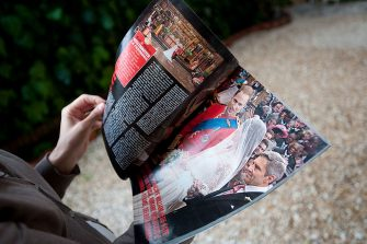 ROME, ITALY - MAY 03:  A girl reads an Italian magazine showing photographs of Prince William, Duke of Cambridge and Catherine, Duchess of Cambridge following their wedding, on May 3, 2011 in Rome, Italy.  The marriage of the second in line to the British throne was led by the Archbishop of Canterbury and was attended by 1900 guests, including foreign Royal family members and heads of state. Thousands of well-wishers from around the world flocked to London to witness the spectacle and pageantry of the Royal Wedding.  (Photo by Giorgio Cosulich/Getty Images)