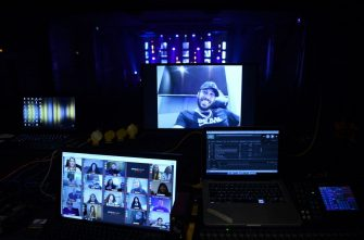 Spectators including Arsenal's Gabonese forward Pierre-Emerick Aubameyang (up) attend by videoconference the live streaming show of French humorists Othman and Kalvin at the Apollo Theatre in Paris on May 14, 2020. - France is easing lockdown measures in place for 55 days to curb the spread of the COVID-19 pandemic, caused by the novel coronavirus. (Photo by FRANCK FIFE / AFP) / RESTRICTED TO EDITORIAL USE - MANDATORY MENTION OF THE ARTIST UPON PUBLICATION - TO ILLUSTRATE THE EVENT AS SPECIFIED IN THE CAPTION (Photo by FRANCK FIFE/AFP via Getty Images)