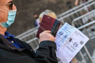 A visitor holds his online-bought entrance ticket as he lines up to enter the Vatican Museums (Musei Vaticani) which reopen to the public on June 1, 2020 in The Vatican, while the city-state eases its lockdown aimed at curbing the spread of the COVID-19 infection, caused by the novel coronavirus. (Photo by ANDREAS SOLARO / AFP) (Photo by ANDREAS SOLARO/AFP via Getty Images)