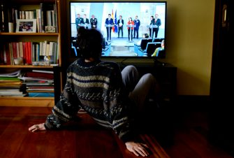 BURGOS, SPAIN - MARCH 16: In this photo illustration, a woman watches TV from her home on March 16, 2020 in Burgos, Spain. Spain will impose a national blockade to combat the coronavirus on March 16, 2020 in several cities. (Photo by Samuel de Roman / Getty Images)
