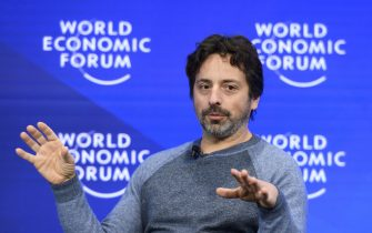 Google co-founder Sergey Brin gestures during a session of the World Economic Forum, on January 19, 2017 in Davos. / AFP / FABRICE COFFRINI        (Photo credit should read FABRICE COFFRINI/AFP via Getty Images)