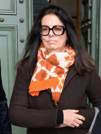 Francoise Bettencourt-Meyers, daughter of France's richest woman Liliane Bettencourt, leaves the courthouse of Bordeaux, southwestern France, on February 2, 2015, on the six day of the trial of ten people charged with exploiting elderly L'Oreal heiress and France's richest woman Liliane Bettencourt. Ten members of Bettencourt's entourage are accused of taking advantage of the 92-year-old billionaire's growing mental fragility in an explosive legal and political drama. AFP PHOTO / MEHDI FEDOUACH / AFP PHOTO / MEHDI FEDOUACH        (Photo credit should read MEHDI FEDOUACH/AFP via Getty Images)