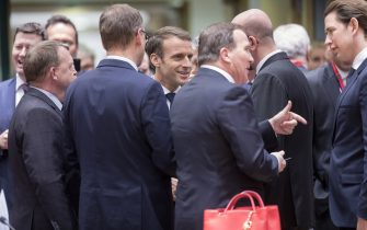 BRUSSELS, BELGIUM - DECEMBER 13; 2018: (From Left) Danish Prime Minister Lars Lokke Rasmussen is talking with the Finish Prime Minister Juha Sipila, the French President Emmanuel Macron, the Swedish Prime Minister Kjell Stefan Lofven, the Belgium Prime Minister Charles Michel and the Austrian Chancellor Sebastian Kurz prior the start of the two day EU summit on December 13, 2018 in Brussels, Belgium. Mrs May yesterday won a vote of confidence in her leadership among her own MPs 200 to 117. Attending the summit she will attempt to secure greater assurances on the temporary nature of the Irish Backstop, in turn hoping to persuade MPs to vote her Brexit Deal through Parliament in the coming weeks.  The 27 European leaders are gathering for a crucial European Union summit with the British Prime Minister.  (Photo by Thierry Monasse/Getty Images)