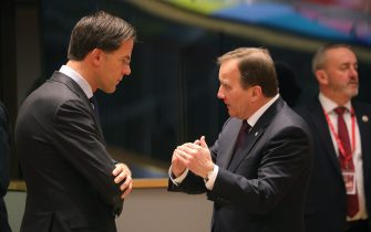 Netherlands' Prime Minister Mark Rutte (L) speaks to Sweden's Prime Minister Stefan Lofven prior a round table on December 14, 2018 in Brussels during the second day of a European Summit aimed at discussing the Brexit deal, the long-term budget and the single market. - EU leaders will approve a modest list of euro single currency reforms on December 14 that are a far cry from the vast overhaul to the European project sought by France. (Photo by LUDOVIC MARIN / AFP)        (Photo credit should read LUDOVIC MARIN/AFP via Getty Images)