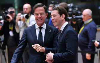 Netherlands' Prime Minister Mark Rutte (L) talks to Austria's Chancellor Sebastian Kurz during a European Summit aimed at discussing the Brexit deal, the long-term budget and the single market on December 13, 2018 in Brussels. - The 27 European leaders gather for a crucial European Union summit with the British Prime Minister seeking a compromise to save the Brexit deal. (Photo by EMMANUEL DUNAND / AFP)        (Photo credit should read EMMANUEL DUNAND/AFP via Getty Images)