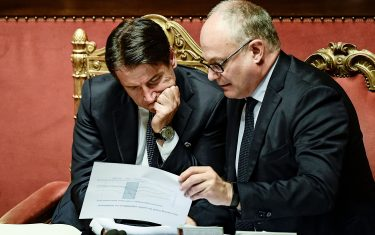 Italy's Prime Minister Giuseppe Conte (L) and Italy's Finance and Economy Minister Roberto Gualtieri go through documents as they wait while the new government's confidence vote is being held on September 10, 2019 during at the Senate in Rome. - Italian Prime Minister Giuseppe Conte called on September 9 for the reform of European Union budget rules and cooperation on immigration as his new government won a parliamentary confidence vote at the lower house. (Photo by Filippo MONTEFORTE / AFP)        (Photo credit should read FILIPPO MONTEFORTE/AFP via Getty Images)