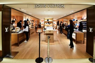 People shop at the Louis Vuitton luxury shop at the Rinascente shopping mall in Milan on May 18, 2020 during the country's lockdown aimed at curbing the spread of the COVID-19 infection, caused by the novel coronavirus. - Restaurants and churches reopen in Italy on May 18, 2020 as part of a fresh wave of lockdown easing in Europe and the country's latest step in a cautious, gradual return to normality, allowing businesses and churches to reopen after a two-month lockdown. (Photo by Miguel MEDINA / AFP) (Photo by MIGUEL MEDINA/AFP via Getty Images)