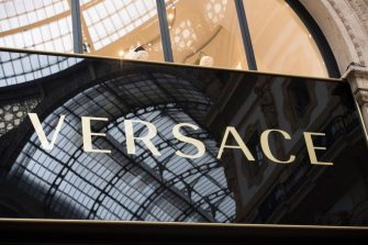 A picture shows the logo of Italian fashion shop Versace in the Vittorio Emanuele II luxury Gallery in the center of Milan on May 3, 2019. (Photo by Miguel MEDINA / AFP)        (Photo credit should read MIGUEL MEDINA/AFP via Getty Images)