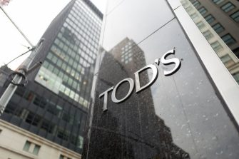 Close-up of sign with logo for Tod's upscale boutique shoe store, with building visible in the background, on Madison Avenue in Manhattan, New York City, New York, September 14, 2017. (Photo by Smith Collection/Gado/Getty Images)