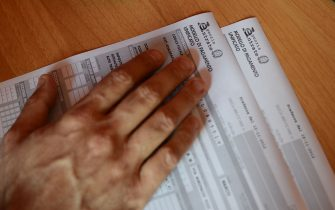 A private business consultant looks at an official tax form on October 22, 2012 in Rome. AFP PHOTO / ANDREAS SOLARO        (Photo credit should read ANDREAS SOLARO/AFP via Getty Images)
