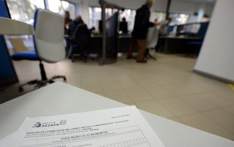 A tax form is displayed on a desk in a tax office on November 7, 2012 in Rome.  AFP PHOTO / ANDREAS SOLARO        (Photo credit should read ANDREAS SOLARO,ANDREAS SOLARO/AFP via Getty Images)