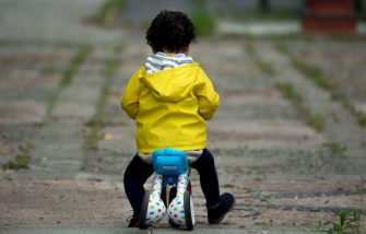 A little child rides a balance trike in a park in Seville, on April 26, 2020 during a national lockdown to prevent the spread of the COVID-19 disease. - After six weeks stuck at home, Spain's children were being allowed out today to run, play or go for a walk as the government eased one of the world's toughest coronavirus lockdowns. Spain is one of the hardest hit countries, with a death toll running a more than 23,000 to put it behind only the United States and Italy despite stringent restrictions imposed from March 14, including keeping all children indoors. Today, with their scooters, tricycles or in prams, the children accompanied by their parents came out onto largely deserted streets. (Photo by CRISTINA QUICLER / AFP) (Photo by CRISTINA QUICLER/AFP via Getty Images)