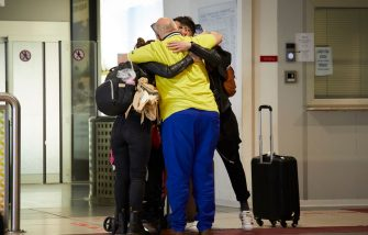 PALERMO, ITALY - JUNE 03:  Parents hug their children at the airport arrivals after the lockdown on June 03, 2020 in Palermo, Italy. Flights have started again from the ease of the Covid-19 lockdown on June 3rd.  (Photo by Lorenzo Palizzolo/Getty Images)
