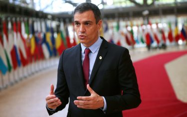 Spain's Prime Minister Pedro Sanchez makes a statement as he arrives for the fourth day of an EU summit at the European Council building in Brussels, on July 20, 2020, as the leaders of the European Union hold their first face-to-face summit over a post-virus economic rescue plan. - The 27 EU leaders gather for another session of talks after three days and nights of prolonged wrangling failed to agree a 750-billion-euro ($860-billion) bundle of loans and grants to drag Europe out of the recession caused by the coronavirus pandemic (COVID-19). (Photo by Francisco Seco / POOL / AFP) (Photo by FRANCISCO SECO/POOL/AFP via Getty Images)