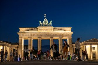 BERLIN, GERMANY - JULY 24: Tourists walk at night at the Brandenburg gate in Berlin on July 24, 2020 in Berlin, Germany. For the German capital, the COVID-19 pandemic has been economically devastating, as its liveihood depends on partygoers and tourism.  (Photo by Maja Hitij/Getty Images)  (Photo by Maja Hitij/Getty Images)