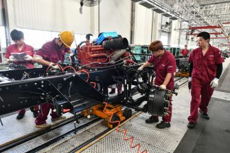 Employees work on a truck assembly line at a factory in Fuyang in China's eastern Anhui province on July 16, 2020. - China's economy returned to growth in the second quarter, rebounding more strongly than expected from a historic contraction caused by the coronavirus outbreak, official data showed on July 16. (Photo by STR / AFP) / China OUT (Photo by STR/AFP via Getty Images)