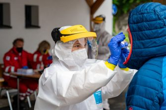 A person is tested on the novel coronavirus in a testing station at the Red Cross office in St Wolfgang, Austria, on July 26, 2020. - The number of people infected with the novel coronavirus that can cause the COVID-19 disease is rising in the Upper Austrian touristic spot of St Wolfgang. (Photo by KERSCHBAUMMAYR / various sources / AFP) / Austria OUT (Photo by KERSCHBAUMMAYR/APA/AFP via Getty Images)