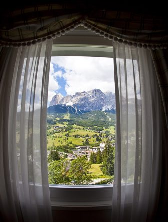 CORTINA D'AMPEZZO, ITALY - JULY 04: Panoramic view from the suite in the 5-Star Hotel Spa and Golf Cristallo, member of The Leading Hotels of the World on July 04, 2011 in Cortina D'Ampezzo, Dolomites, Italy.Cortina is famous for skiing in winter and hiking, climbing, mountainbiking in summer.  (Photo by EyesWideOpen/Getty Images)