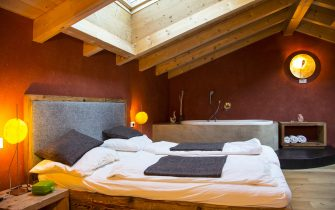 MERAN, ITALY - APRIL 13:  Luxury sleeping room with whirlpool bathtube in a Hotel as ecological farm house on April 13, 2013 near Meran, Vinschgau, South Tyrol, Italy  (Photo by EyesWideOpen/Getty Images)