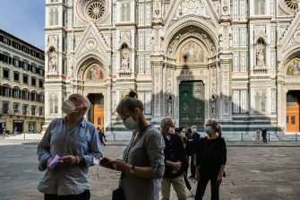 FLORENCE, ITALY - MAY 22:  Tourists queue to enter the Baptistery in front of the Cathedral of Florence as it opens following its closure due to coronavirus on May 22, 2020 in Florence, Italy. The monuments of the Florence Cathedral are to reopen to the public after closure due to the Covid-19 pandemic. Until the end of May it will be possible to visit the Cathedral of Florence, the Baptistery, Giotto's Bell Tower and the Museo dell'Opera del Duomo free of charge, with compulsory online reservations.  (Photo by Laura Lezza/Getty Images)