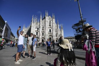 Tourists take pictures in front of the Duomo Cathedral, the largest church in Italy, in central Milan on May 30, 2019. (Photo by Miguel MEDINA / AFP)        (Photo credit should read MIGUEL MEDINA/AFP via Getty Images)
