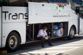 A bus driver waits for tourists outside the airport in Palma de Mallorca on July 27, 2020. - Tour operator TUI has cancelled all British holidays to mainland Spain from today until August 9, after the UK government's decision to require travellers returning from the country to quarantine. (Photo by JAIME REINA / AFP) (Photo by JAIME REINA/AFP via Getty Images)