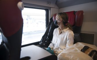 TURIN, ITALY - JUNE 03: A traveler wearing a protective mask sits inside a Italo Train before departing at the Porta Nuova railway station on June 03, 2020 in Turin, Italy. Today 3 June the Italian government has reopened the regional borders thus giving Italians the opportunity to move between the regions again and be able to go to relatives and go on holiday within the Italian borders. Many Italian businesses have been allowed to reopen, after more than two months of a nationwide lockdown meant to curb the spread of Covid-19. (Photo by Stefano Guidi/Getty Images)