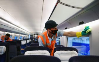Employees of Germany's public rail operator Deutsche Bahn (DB) clean an inner compartment of an ICE train at a maintenance depot of DB in Dortmund, western Germany, on June 17, 2020 amid the new coronavirus pandemic. (Photo by Ina FASSBENDER / AFP) (Photo by INA FASSBENDER/AFP via Getty Images)