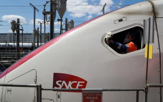 ONET employees desinfect TGV trains locomotive at the SNCF atlantic technicenter, on may 14, 2020, in Chatillon, as the lockdown introduced two month ago to fight the spread of the Covid-19 diseased caused by the novel coronavirus starts to ease. (Photo by Ludovic MARIN / AFP) (Photo by LUDOVIC MARIN/AFP via Getty Images)