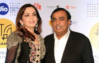 Chairman of Reliance Industries Mukesh Ambani with his Wife Nita Ambani attend the Jio MAMI 18th Mumbai Film Festival opening ceremony at the Royal Opera House, which was being re-launched after 23 years, in Mumbai on October 20, 2016. / AFP / -        (Photo credit should read -/AFP via Getty Images)