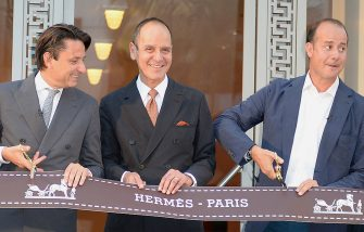 Robert Chavez (C), president and CEO of Hermes USA, Axel Dumas, (L), CEO of Hermes International and Pierre-Alexis Dumas, (R), Hermes International artistic director, cut the ribbon at the opening on the new Hermes boutique in Beverly Hills, California September 3, 2013.  AFP PHOTO / Robyn Beck        (Photo credit should read ROBYN BECK/AFP via Getty Images)