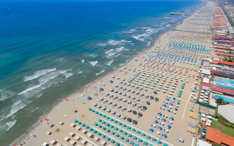 Aerial view of Viareggio seacoast - beach during the fly with helicopter HH412C, Volpe 220, of the Aerial Section of the Italian Finance guard (Guardia di Finanza) as patrol areas and seacoast over Tuscany region against illegal activity and crowd of people during the country's emergency period aimed at contains the spread of the Covid-19 coronavirus, Lido di Camaiore, Italy, 15 August 2020. ANSA/FABIO MUZZI