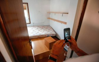 A picture taken on August 19, 2017 with the agreement of the flatmate of imam Abdelbaki Es Satty shows the room of the imam, after police officers carried out a search linked to the deadly terror Barcelona attack at the home in Ripoll, two days after a van ploughed into the crowd, killing 13 persons and injuring over 100. The El Pais daily, quoting police sources, said the imam could be one of the dead in the explosion of Alcanar. Drivers have ploughed on August 17, 2017 into pedestrians in two quick-succession, separate attacks in Barcelona and another popular Spanish seaside city, leaving 14 people dead and injuring more than 100 others. / AFP PHOTO / PAU BARRENA        (Photo credit should read PAU BARRENA/AFP via Getty Images)