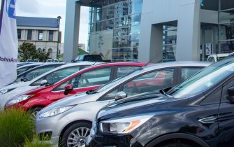 Small cars are on display in front of the John Andrew Ford car dealership in Auckland, New Zealand, February 26, 2018. (Photo by Smith Collection/Gado/Getty Images)