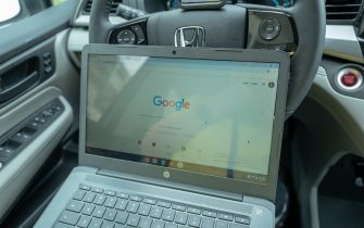 Remote work setup in automobile with Chromebook laptop during COVID-19 coronavirus outbreak in San Francisco, California, March 30, 2020. During the outbreak, many workers have been forced to find creative work at home solutions to respond to lockdowns. (Photo by Smith Collection/Gado/Getty Images)