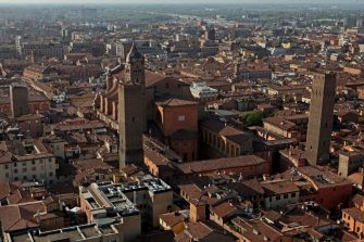 BOLOGNA, ITALY - MARCH 30: The Metropolitan Cathedral of San Pietro, la Cattedrale Metropolitana di San Pietro, is seen with the Torre Azzoguidi (L) in front of its bell-tower on March 30, 2017 in Bologna, Italy. As many as 180 towers are believed to have been built between the 12th and the 13th centuries but only a few remain standing today. (Photo by David Silverman/Getty Images)