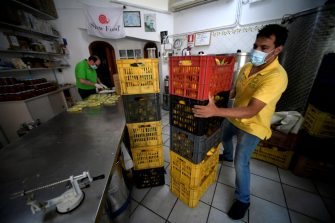 An employee is at work at the Limoncello factory, extension of the Aceto family lemon tree farm, on July 2, 2020 in Amalfi. (Photo by Filippo MONTEFORTE / AFP) (Photo by FILIPPO MONTEFORTE/AFP via Getty Images)