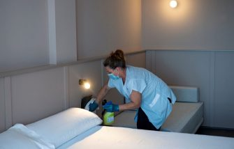 A hotel employee cleans a room in Lloret de Mar on June 22, 2020. - EU member state citizens and those from the passport-free Schengen zone were allowed freely into Spain, with no 14-day quarantines required following a national lockdown to stop the spread of the novel coronavirus. (Photo by Josep LAGO / AFP) (Photo by JOSEP LAGO/AFP via Getty Images)