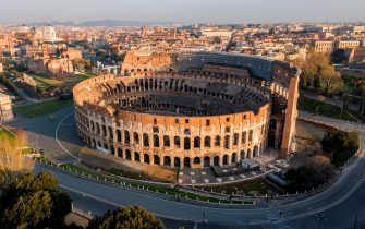 TOPSHOT - A morning aerial photo taken on March 30, 2020 shows deserted streets and the Colosseum monument in Rome during the country's lockdown aimed at curbing the spread of the COVID-19 infection, caused by the novel coronavirus. (Photo by Elio CASTORIA / AFP) / Italy OUT (Photo by ELIO CASTORIA/AFP via Getty Images)