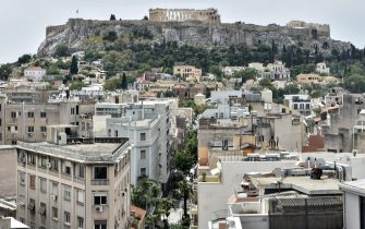 """A picture taken on May 19, 2019 shows a view of the historic Athens center, taken from a brand-new boutique hotel. - Battered by the crisis that ravaged the rest of the country, Athens will have a new mayor on June 2, 2019 and a challenge to push back the results of a long recession. According to outgoing deputy Athens mayor Lefteris Papagiannakis, the number of visitors more than doubled in recent years owing to a certain """"notoriety"""" attached to the city's image. There has also been an expansion of street art and a proliferation of socio-cultural centers -- meeting points for artists, professionals and refugees -- that arose in response to the collapse of state-funded welfare. (Photo by LOUISA GOULIAMAKI / AFP)        (Photo credit should read LOUISA GOULIAMAKI/AFP via Getty Images)"""