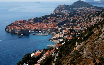 """DUBROVNIK, CROATIA - JULY 28: The city of Dubrovnik as seen from the mountain Std on July 28, 2020 in Dubrovnik, Croatia. Located in southern Dalmatia, Dubrovnik is Croatia's premier visitor destination, thanks in part to its role as a filming location for the television series """"Game of Thrones"""". The Old City of Dubrovnik was added to the UNESCO World Heritage List in 1979. The European tourism industries have been hit hard by restrictions in response to the outbreak of COVID-19. (Photo by Dominik Bindl/Getty Images)"""