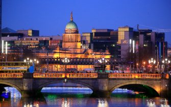 River Liffey in foreground and the Custom House dome as background pictured at dusk on April 20, 2016 in Dublin, Ireland. Illustrative picture of the Irish capital city center.
