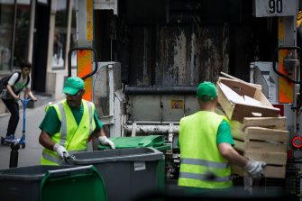 French garbage collectors empty dustbins into a refuse truck on June 10, 2016 in central Paris.   On June 10, the day of the start of Euro 2016 in France, rubbish piled up in parts of Paris as trains were disrupted from strikes and political turmoil over labour reforms dragged on. The piles of uncollected household rubbish accumulating in parts of the capital, giving off a foul smell as the temperatures rise, was hardly the image of France that the Euro 2016 organisers want to convey. / AFP / GEOFFROY VAN DER HASSELT        (Photo credit should read GEOFFROY VAN DER HASSELT/AFP via Getty Images)