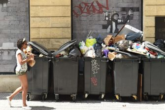 TOPSHOT - This picture taken in Bordeaux on June 28, 2016 shows wastes overflowing the dustbins. - The garbage collectors are on strike in Bordeaux since seven days, as unions have called repeated strikes and marches against controversial labour reforms, forced through by the government of Socialist President Francois Hollande. (Photo by NICOLAS TUCAT / AFP) (Photo by NICOLAS TUCAT/AFP via Getty Images)